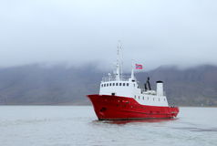 Norwegian boat docked at the port of Longyearbyen Stock Photography