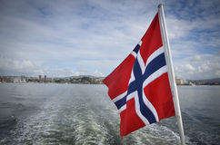 Norwegian boat with flag. A boat on the sea with the Norwegian flag Royalty Free Stock Images