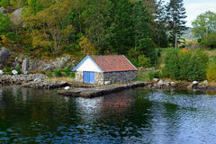 Norwegian boat house of granite Stock Photo