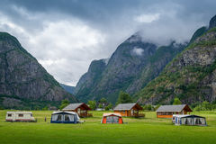 Norwegian camping houses under the high mountains of Eidfjord. Stock Photos