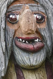 Norwegian carved wooden face detail troll. Scandinavian folklore Royalty Free Stock Images