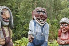 Norwegian carved wooden troll sculptures. Scandinavian folklore. Stock Photos