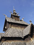 Norwegian Church. Norwegian wooden church of the Middle Ages, with the roofs and symbols Vikings Royalty Free Stock Photos