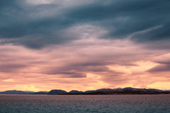 Norwegian coastal landscape, colorful stormy sky stock photo