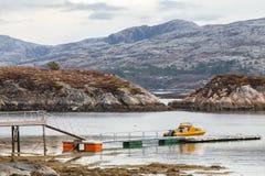 Norwegian coastal landscape. Small motor boat Royalty Free Stock Images