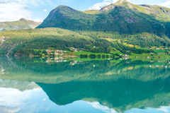 Norwegian coastline reflection fishing town.  Royalty Free Stock Image