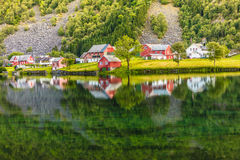 Norwegian country houses in the mountains on lake shore Stock Image