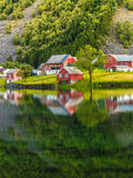Norwegian country houses in the mountains on lake shore Stock Photo