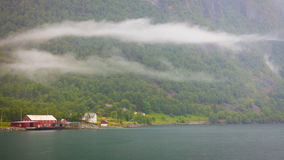Norwegian country houses in the mountains on lake shore Royalty Free Stock Photo