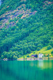 Norwegian country houses in the mountains on lake shore Royalty Free Stock Image
