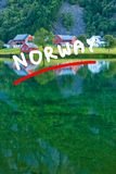 Norwegian country houses in the mountains on lake shore Stock Images