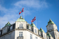 Norwegian and Danish flag on the rooftop Royalty Free Stock Images