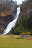 Norwegian fall. Waterfall falling to the sea in Norway Royalty Free Stock Image