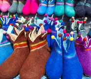 Norwegian felt slippers. Traditional Norwegian felt slippers in bright colors on display Royalty Free Stock Photos
