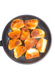Norwegian fish pudding in a frying pan Royalty Free Stock Images