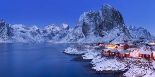 Norwegian fisherman`s cabins on the Lofoten in winter. Traditional Norwegian fisherman`s cabins, rorbuer, on the island of Hamnøy, Reine on the Lofoten in stock image