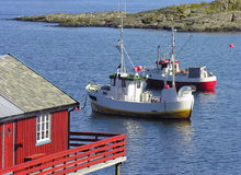 Norwegian  fishing boat. Fishing boat in norwegian sea with a red house, Norway Royalty Free Stock Image