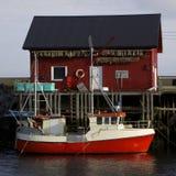 Norwegian fishing boat. With fishing house on island of Vaeroy, Lofoten Royalty Free Stock Image