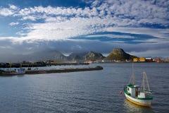 Norwegian fishing port. With traditional fishing boat on island of Vaeroy, Lofoten islands Stock Photo