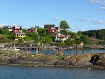 Norwegian fishing village on the coast. In late summer Stock Photo