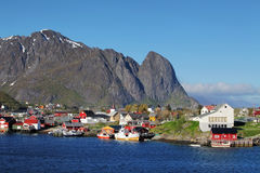 Norwegian fishing village with traditional red rorbu huts, Reine Royalty Free Stock Image