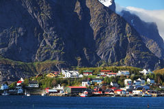 Norwegian fishing village with traditional red rorbu huts, Reine, Lofoten Islands, Norway royalty free stock photography