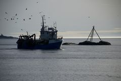 Norwegian fishingboat. On the way out to the sea stock photo