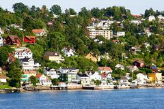 Norwegian Fjord. Houses on the side of a Norwegian Fjord on the outskirts of Oslo Stock Images