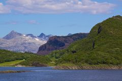 Norwegian Fjord. Typical Norwegian fjord surrounded by steep mountains Stock Image