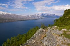 Norwegian fjord. Typical deep norwegian fjord near polar circle Royalty Free Stock Image
