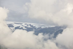 Norwegian fjord cloudy landscape with glacier. Norway adventure Stock Photo