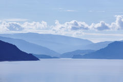 Norwegian fjord landscape in blue tone. Tourism Norway. Travel Royalty Free Stock Images