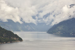 Norwegian fjord landscape with mountains and clouds. Sorfjorden. Stock Photography