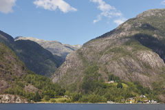 Norwegian fjord landscape with mountains and houses. Sorfjorden. Stock Photos