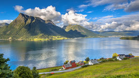 Norwegian fjord landscape on sunny day. In august with houses and villages near Volda Stock Photo