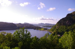 Norwegian fjord landscape. View of amazing fjord in Norway accompanied by blue sky stock photos
