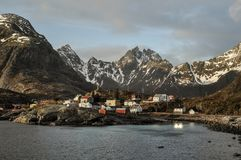 Norwegian Fjord on Lofoten Islands with typical houses and a sky royalty free stock images