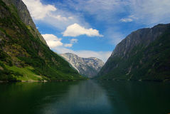 Norwegian fjord and mountains. Idyllic view fjord and mountains of Norway .Clouds and blue sky stock images