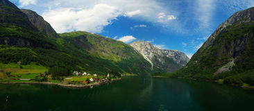 Norwegian fjord and mountains. Stitched Panorama Idyllic view fjord and mountains of Norway .Clouds and blue sky stock photography