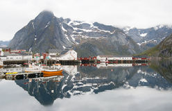 Norwegian fjord with reflection in water Royalty Free Stock Photography