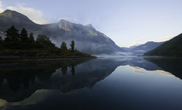 Norwegian fjord. Scenic view of mountains reflecting on a Norwegian fjord stock images
