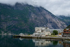 Norwegian fjord town and mountain a background. Norway. Royalty Free Stock Photography