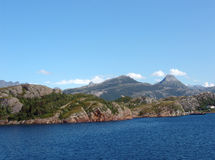 Norwegian fjord. View of the coastline of the fjord from the ferry royalty free stock photo