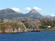 Norwegian fjord. View of the coastline of the fjord from the ferry royalty free stock photos