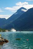 Norwegian fjord with white ferry on blue water. Stock Images
