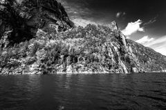 Norwegian fjords. Blue sky and falls, water, BW Royalty Free Stock Image