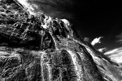 Norwegian fjords. Blue sky and falls, water, BW Royalty Free Stock Images