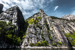 Norwegian fjords. Blue sky and falls, water, color Stock Images
