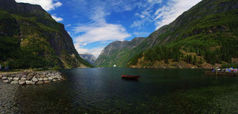 Norwegian fjords. Boat and cruise ship in the Norwegian fjords royalty free stock photo
