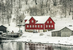 Norwegian Fjords. Wooden houses on the banks of the Norwegian fjord, beautiful mountain landscape in winter Royalty Free Stock Image
